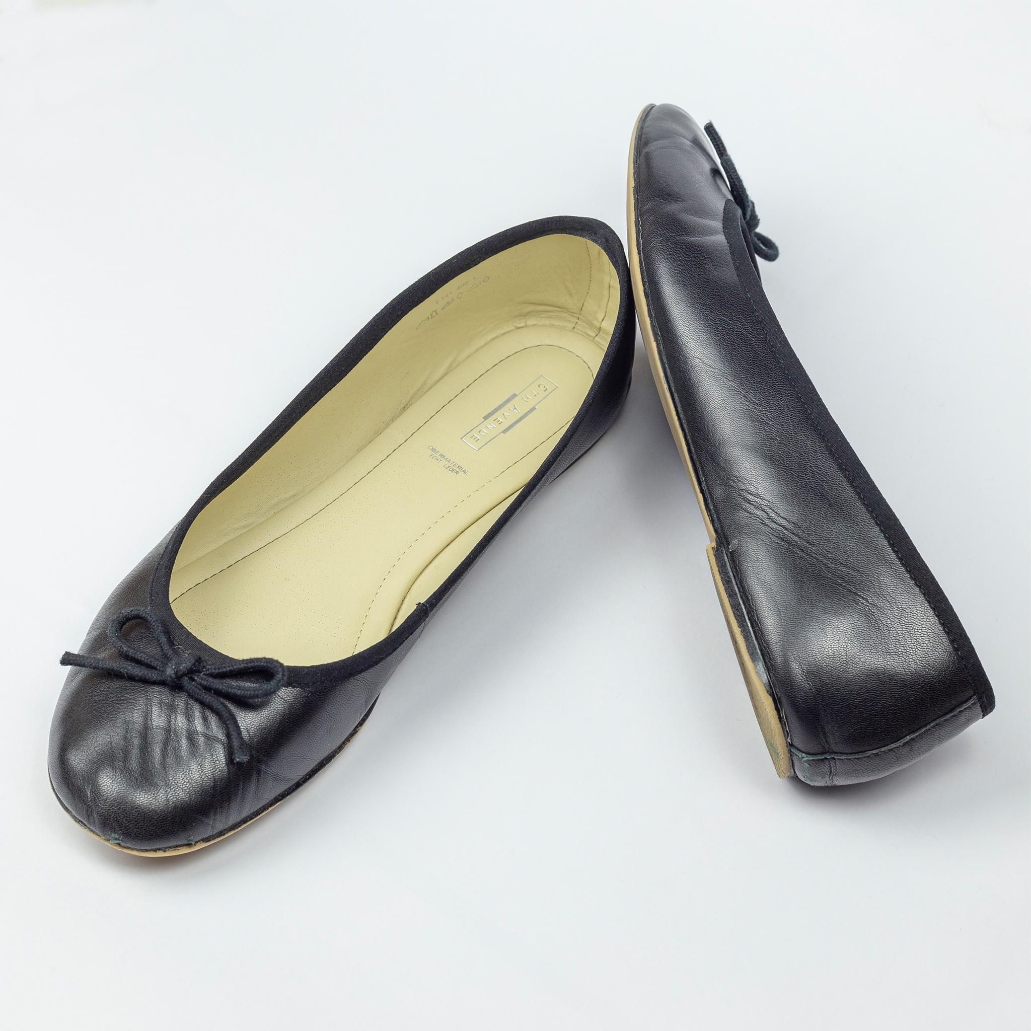 Schwarze Ballerinas Oversized Heel